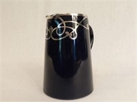Small pitcher with silver overlay