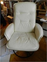 Pair of Mid-Century modern white swivelling leather chairs, marked Made in Sweden, sold separately, estimate $300-$500 each