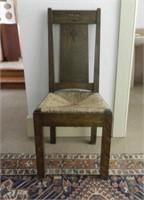 Oak chair, cross symbol on back