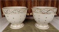 Pair of early 19th Century two-handled Derby cache pots, painted with flowers and gilt; with shells for handles