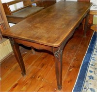Walnut library table with carved knees, original surface