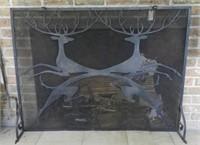 Wrought iron fire screen, pair of jumping deer