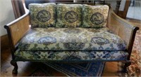 Regency sofa with caned back and sides