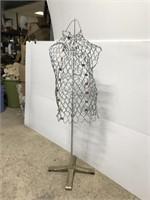 Vintage dress form on metal stand