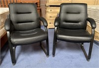 11 - PAIR OF BLACK OFFICE CHAIRS