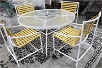 714 - ROUND GLASS & METAL PATIO TABLE W/ 4 CHAIRS