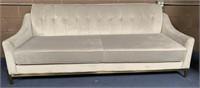 C - BEAUTIFUL LONG OFF WHITE SOFA W/GOLD BASE