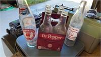 4 PAK OF DOCTOR PEPPER BOTTLES , 1 PEPSI BOTTLE