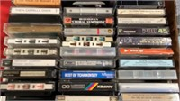 CASE AND BOX OF CASSETTE TAPES