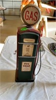 GAS PUMP MADE OF TIN  AND IS A COIN BANK ,