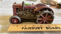 RED METAL ANTIQUE TOY TRACTOR