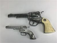 Two Toy Hand Guns + Gun Rack