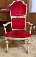 Red velvet upholstered chair