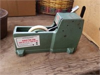 CAST IRON CONTAINER AND A  TAPING MACHINE