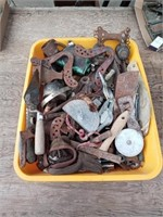 YELLOW BIN OF METAL PARTS AND PIECES