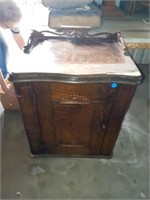 ANTIQUE MONOGRAM SEWING MACHINE IN A WOOD