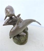 Carved Dolpphin Trio By Wayne Inknster