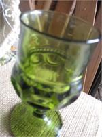 Box full of green depression glass