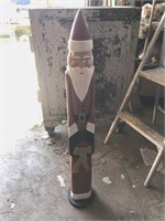 Two wooden Santa Claus