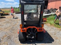 Kubota BX1500 4x4 tractor w/mower, plow & bagger