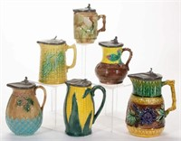 Collection of ceramic syrup pitchers
