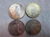 4 Peace silver dollars