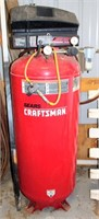 Lot 5012 - Craftsman Upright Air Compressor, Click catalog tab to view information & more pics of this item.  This item has absentee bidding.