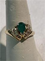 Emerald and diamond fashion ring. Size 6 1/2.